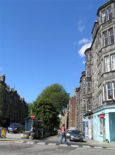 Roseneath Place separated by a tree bank from Marchmont Crescent, at the junction with Warrender Park Road