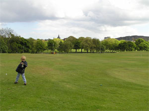 Bruntsfield links with view across the tree lined Melville Drive to Salisbury Crags